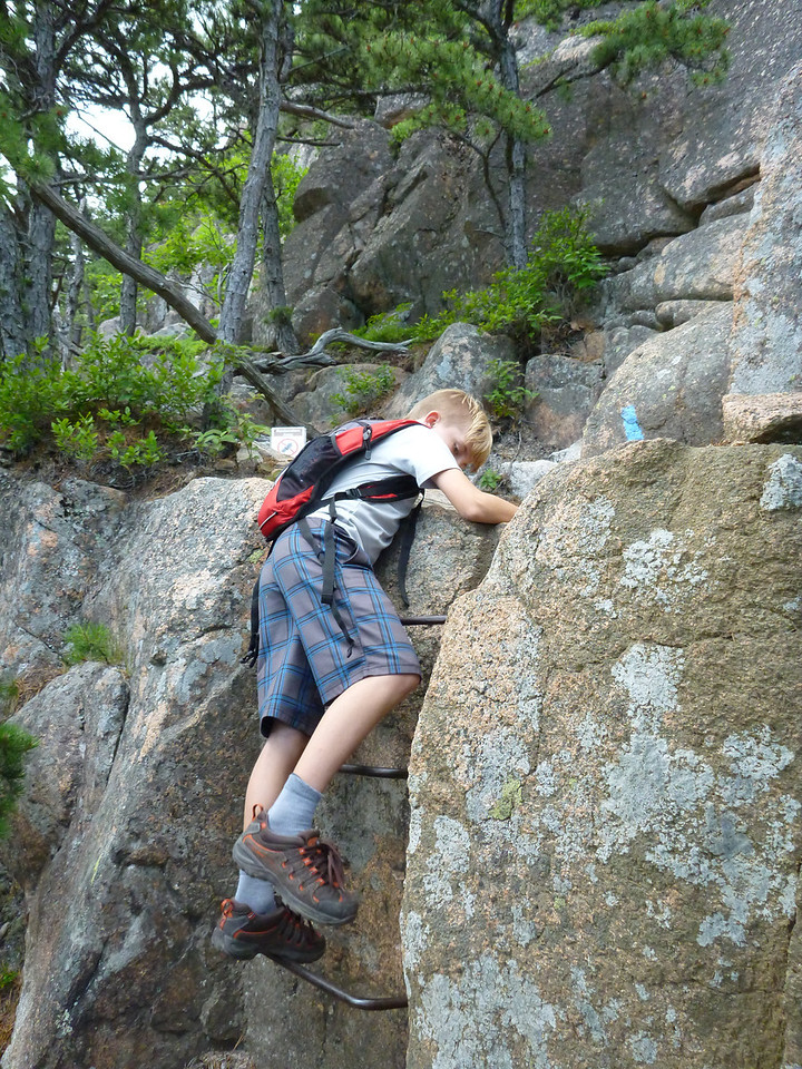 Drew climbing on one of the hiking trails