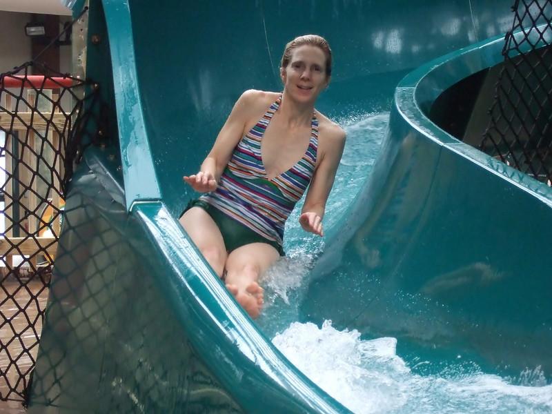 Lynne coming down a water slide