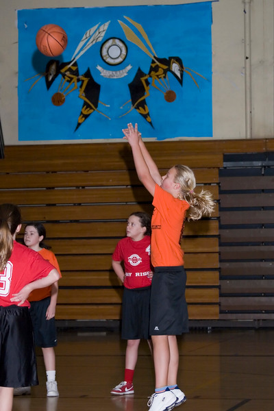 Lisa shoots a freethrow.