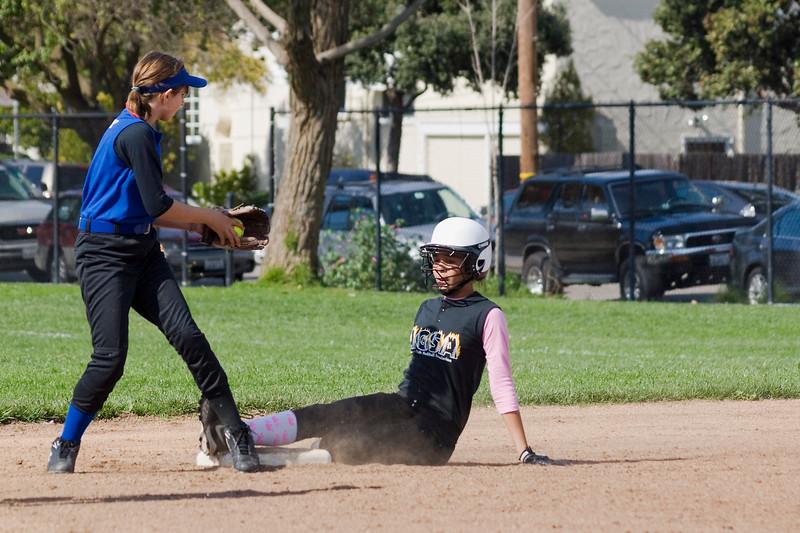 Kiki slides at second base.