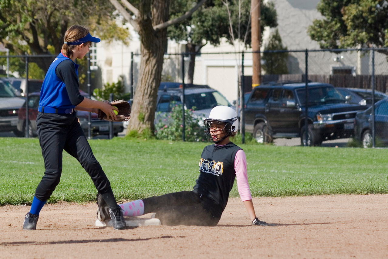 Kiki slides at second base.