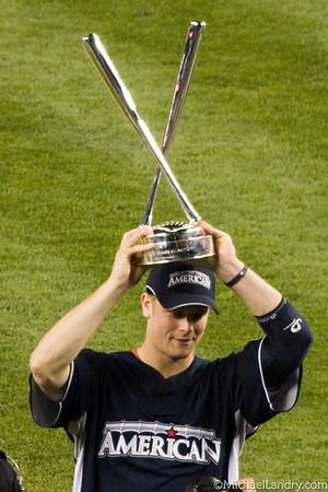 Justin Morneau hoists the trophy