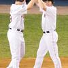 Justin Morneau (L) celebrates J.D. Drew after scoring on Drew's 2-run homer