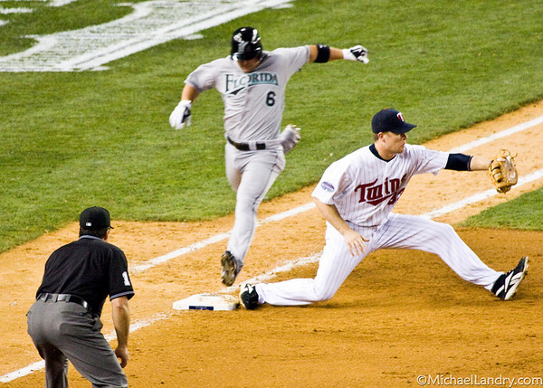 Dan Uggla grounds into a double-play; Justin Morneau is on first base