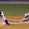 Dioner Navarro reaches for the ball as Miguel Tejada scores