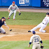 Justin Morneau tries to score to win the game