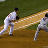 Justin Morneau plays first base (L) while David Wright leads towards second