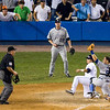 Dioner Navarro is tagged out at home by Russell Martin (throw by Nate McLouth) while Aaron Cook watches