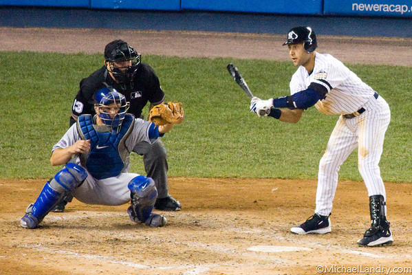 Derek Jeter watches a pitch come in...