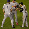 Strategy session: (L to R) Corey Hart, Ryan Ludwick, Nate McLouth
