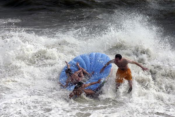 People attempting to ride the Colorwheel Fun Island.