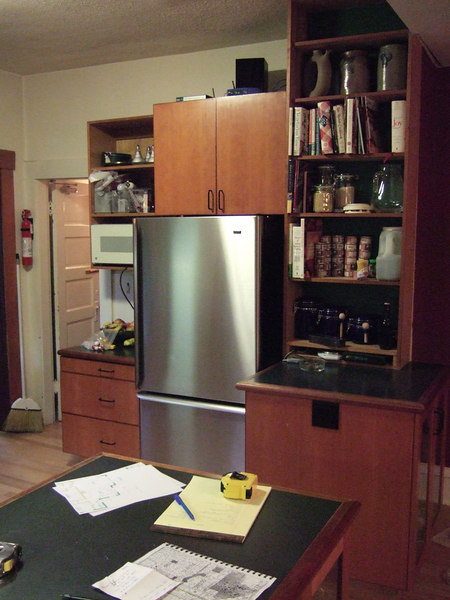 There is a chimney hidden in the wall to the right of the refrigerator.  The old kitchen had two small peninsula cabinets.  We removed the one in front of the chimney and made the other one larger.
