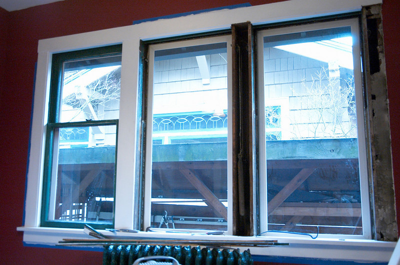 Halfway through taking the windows apart, replacing the sash cords, and fixing up the window trim.  The dining room windows didn't open when we moved in and after this work they were fully operational.