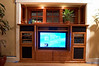 Everything installed, cabinet open, TV on