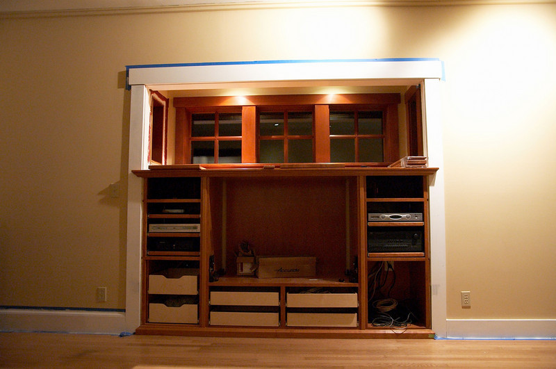 The cabinets are in, but no doors or trim.  <br /> <br /> The large center cabinet is for the TV.  On each side of the TV there are shelves on drawer slides for stereo and video components.  Under the TV there are 5 deep drawers for holding CDs (about 200 CDs per drawer).