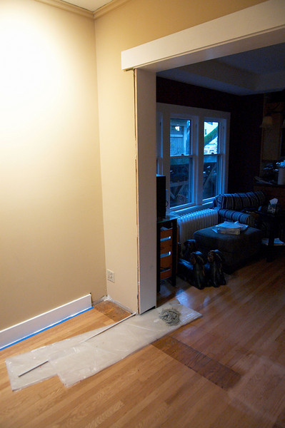 There used to be tall cabinets here seperating the living room and dining room.  We replaced them with a bench seat.