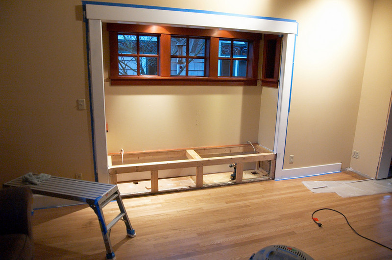 This was a bench seat when we moved into the house.  It wasn't very functional because the windows were tiny and don't get much sunlight anyway.  It was the ideal bump-out to put some cabinets into.