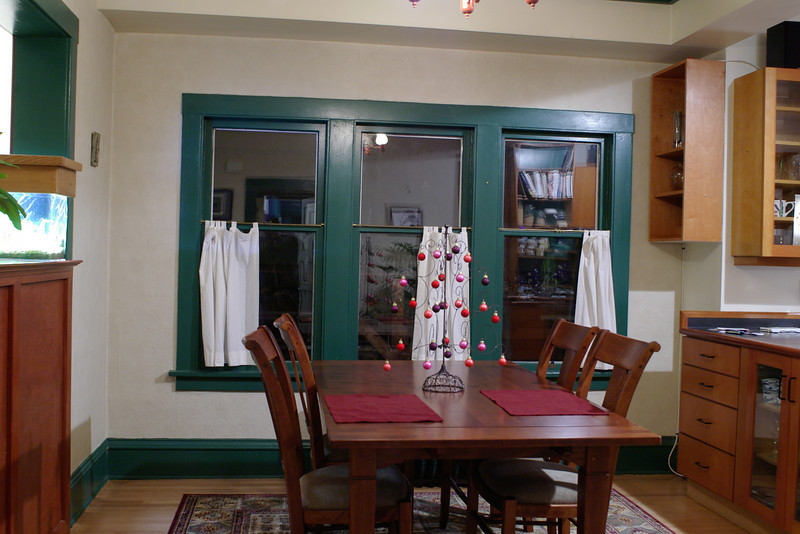 The dining room from when we moved in.  Lumpy walls, green trim, a big cabinet between the living room and dining room, and windows that didn't open.