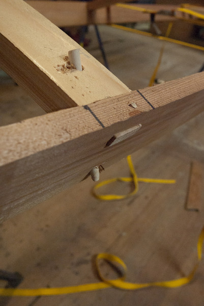 "There are two pegs holding each deck rail in place.  A 1/8"" through the top, and a 1/4"" on a diagonal.  This is a strong joint (and no glue)."