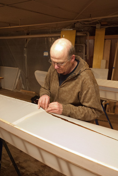 Dave is sewing the bow of his boat