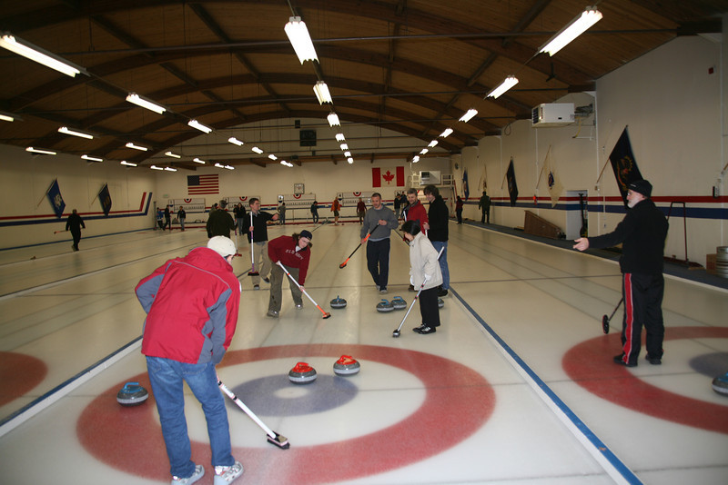 This was my best throw.  You can barely see me in the red sweater (not the orange coat) at the far end of the sheet.  The blue stone that Brett (red old navy sweatshirt) is sweeping is the one that shot and in motion.