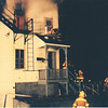 Jewitt City, Heavy fire vents out three windows, on the 3rd floor.<br /> The firefighter on the roof, was the first use of FAST/Rit in the area.