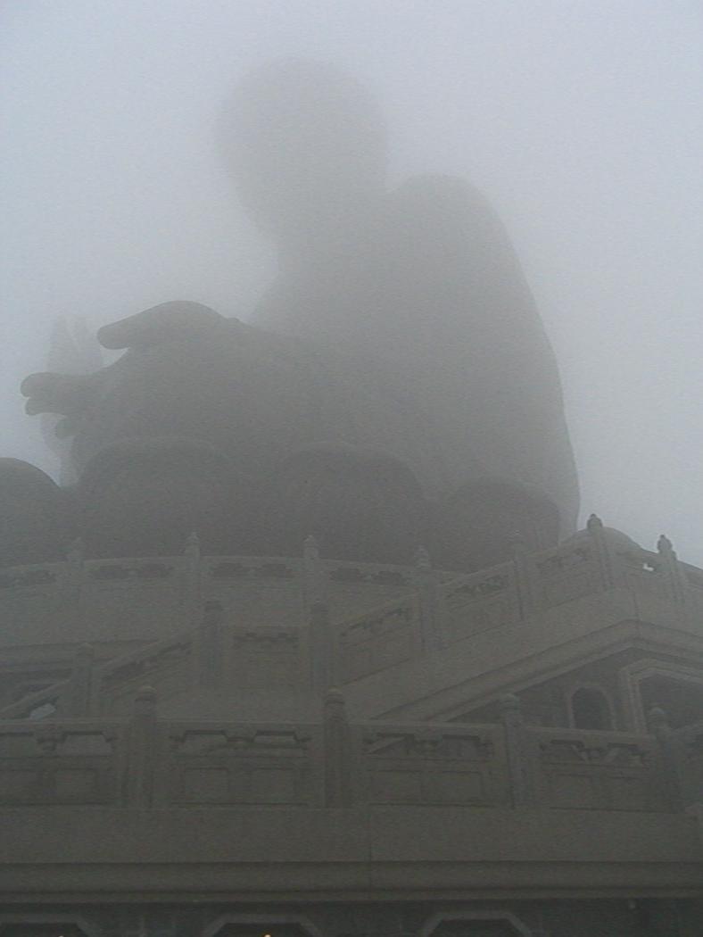 A photo of the Tian Tan Buddha (Big Buddha) shrouded in mist - Lantau, Hong Kong, China.  Travel photo from Lantau, Hong Kong, China.