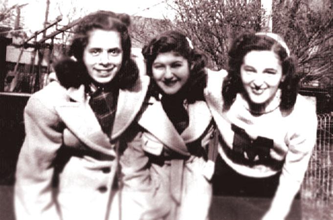 Cynthia Schwartz  in middle with high school friends, Connie Greenburg and Rhoda Hyman.  Picture was taken in their back yard at Homecrest Avenue in Brooklyn.