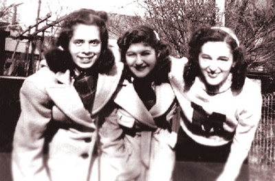 Cynthia Schwartz  in middle with high school friends, Connie Greenburg and Rhoda Hyman.  Picture was taken in their back yard at Homecrest Avenue in Brooklyn.