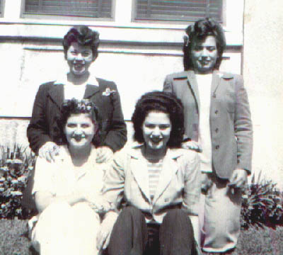 In front of Cynthia's house on 49th Street.  Cynthia with friends.  Front:  Cynthia and Mirium (Used to date Irving Shuster who was crazy about her, but she didn't like Irving.)  Rear:  Buelah Lastname?, Vera Brody