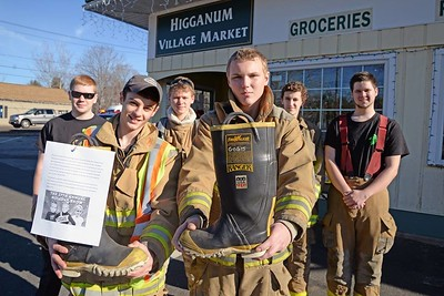 "On Dec. 12, 2015, the Haddam Volunteer Fire Company's Junior Division hosted a ""Fill the Boot"" drive in front of the Higganum Village Market. All proceeds will benefit Haddam Killingworth High School's 27th annual Holiday Show Telethon which is raising funds and awareness for the Children's Tumor Foundation (CTF.org). (Photo by Olivia Drake)"