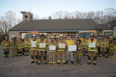 "When members of Haddam Volunteer Fire Company learned that 5-year-old Seth Lane was suffering from a genetic condition called Severe Combined Immunodeficiency, or ""Bubble Boy"" disease, they wanted to show the U.K. resident that he had support here in Haddam, Conn.  To encourage Seth to keep fighting, his parents have asked people around the world to wear yellow to support him on March 27, 2015 when he will undergo a bone marrow transplant. People can post photos online via Twitter, Facebook and Instagram and they will print out the pictures and hang them in Seth's hospital room. Seth, who loves the children's television shows Fireman Sam, PAW Patrol and the color yellow, is receiving the support from more than 40 Haddam firefighters and Junior members who donned their yellow-striped turnout gear, in front of yellow fire trucks, holding signs of encouragement. Seth also is receiving photos of Fireman (Chief) Sam Baber and Booster, the HVFCo. mascot, who resembles the character ""Marshall"" on PAW Patrol.  (Photo by Olivia Drake)"