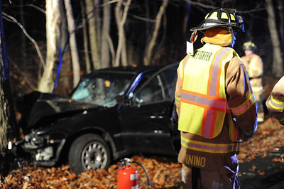 Haddam Volunteer Fire Company responded to a motor vehicle accident at 11:45 p.m. Nov. 6, 2015 on Killingworth Road. A driver, heading southbound on Killingworth Road in Haddam lost control of his vehicle and struck a tree. Firefighters and EMTs removed the driver from his vehicle and transported him to Hartford Hospital via Haddam Volunteer Ambulance Service. The accident is under investigation by the Connecticut State Police. (Photo by Olivia Drake)