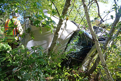 Haddam Volunteer Fire Company responded to a motor vehicle accident  on Route 9N between Exits 7 and 8 at 4:50 p.m. Sept,. 15, 2015. A driver lost control of her vehicle and drove over the embankment, flipping the vehicle onto the driver's side. The driver was able to crawl out of the vehicle and was transported to Middlesex Hospital via Haddam Volunteer Ambulance with minor injuries. Haddam's Rescue 5-13 stayed on scene while towing services removed the vehicle from the median. Chester Hose Company Inc. provided mutual aid. (Photo by Olivia Drake)