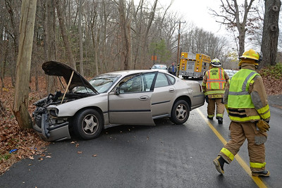 Haddam Volunteer Fire Company was dispatched to a car vs. pole motor vehicle accident at 2:15 p.m. Nov. 16 on Candlewood Hill Road. A driver lost control of her vehicle, struck and cracked a utility pole. Airbags were deployed in the crash. Firefighters helped the driver exit her vehicle and Haddam Volunteer Ambulance personnel transported the driver to Middlesex Hospital. Members of Haddam Fire routed traffic away from the scene until Eversource arrived. (Photo by Olivia Drake)