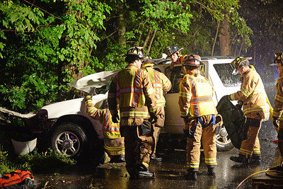 Haddam Volunteer Fire Company responded to a motor vehicle accident around 10:15 p.m. Aug. 11, 2015 near the intersection of Killingworth Road and Hidden Lake Road in Higganum. Firefighters shut down traffic on Killingworth Road for about two hours. The driver lost control of his vehicle and crashed into a tree. Firefighters extricated the patient, who was transported via Haddam Ambulance to Hartford Hospital where he is in stable condition. (Photo by Olivia Drake)