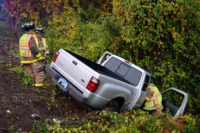 Haddam Volunteer Fire Company responded to a motor vehicle accident at 5:40 p.m. Oct. 9, 2015 on the Exit 9 north-bound on ramp from Killingworth Road. In rainy, wet road conditions, a driver lost control of her vehicle, struck a guard rail and went over the embankment. The driver was transported to Middlesex Hospital via Haddam Volunteer Ambulance Service with minor injuries. In addition to closing the ramp to traffic, Haddam firefighters assisted the tow truck service with removing the vehicle from the steep embankment.  (Photo by Olivia Drake)