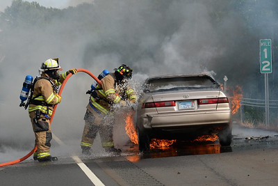 "Haddam Volunteer Fire Company responded to a vehicle fire just after 5 p.m. Aug. 6, 2015 on Route 9S near Exit 8. The driver noticed smoke in her car and quickly pulled to the shoulder and exited the vehicle. Upon arrival, Haddam firefighters found the vehicle completely engulfed in flames. They used a 1 3/4"" hose off Haddam's Engine 1-13 to extinguish the fire. Traffic was shut down on Route 9 for about 20 minutes.  (Photo by Olivia Drake)"