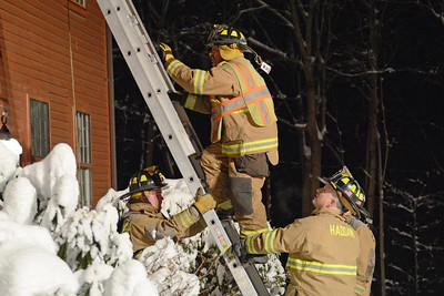 On Feb. 4, 2014 members of Haddam Volunteer Fire Company responded to a chimney fire with extension on Dickinson Road. The home was built in 1797. (Photo by Olivia Drake)