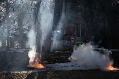 Haddam Volunteer Fire Company responded to a utility pole fire just after 4:30 p.m. on April 1,2015 at 1292 Saybrook Road in Haddam. A tree branch had fallen, crossed the power line and snapped the line in half. Both ends of the wires fell and arced to the ground for about 20 minutes causing several fire flame-ups along side the road. Firefighters shut down traffic for about 45 minutes as EverSource de-energized the pole. Once EverSource deemed the area safe, firefighters used a hose line from Engine 1-13 to cool the ground, which had the potential to be about 2,000 degrees. The area was so hot, water boiled on the surface. While using New York hooks to penetrate the ground, firefighters removed three rocky masses called fulgurites. Fulgurites are irregularly shaped tubes formed by fusion when lightning, or in this case, electricity, strikes sand. The intense heat of the arc and the high current flowing into the ground causes sand, rocks, and minerals in the soil near the line to fuse into a glassy, lava-like substance. (Photo by Olivia Drake)