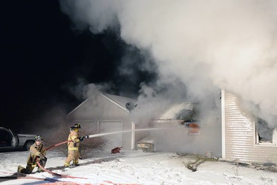 At 7:15 p.m. Jan. 10, 2015 a structure fire was reported at a two-story colonial on Killingworth Road (Rt. 81). Heavy fire and smoke was showing on arrival. Fire suppression required the efforts of seven area fire departments including Haddam, Killingworth, Chester, Durham, Clinton, East Haddam and Haddam Neck, also joined by Haddam Volunteer Ambulance Service. Middletown South District provided a Rapid Intervention Team and Essex provided station coverage for Haddam. The homeowner was inside at the time of the fire but escaped without injury. Traffic was diverted for approximately three hours while the scene remained active. (Photo by Olivia Drake)