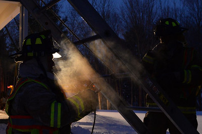 Haddam Volunteer Fire Company responded to a chimney fire at 6:15 a.m. Jan. 29, 2015 at a residence on Christian Hill Road. Exterior firefighters on the roof dropped chains to knock burning debris within the chimney stack while interior firefighters removed the ashes from the home's wood stove. The homeowners were advised to get their chimney swept. (Photo by Olivia Drake)