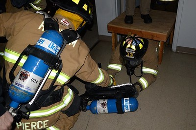 On Nov. 23, 2015 members of Haddam Volunteer Fire Company participated in a SCBA (self-contained breathing apparatus) exercise. All interior firefighters are required to take quarterly SCBA refreshers to keep their interior firefighting status. During the drill, firefighters crawled down a dark hall, over an obstacle that resembled floor joists in a ceiling, and searched a room. They concluded the drill with a low-profile exercise. Firefighters and members of Haddam Fire's Junior Division then cleaned SCBA and refilled air tanks. (Photo by Olivia Drake)