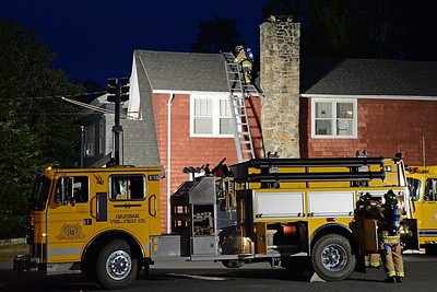 During their weekly Monday drill Sept. 21, 2015 members of Haddam Volunteer Fire Company practiced setting up ladders, ladder safety and chimney fire response at the Veteran's Museum in Higganum (formerly the old fire house) on Candlewood Hill Road. (Photo by Olivia Drake)