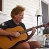 Greg Miller plays guitar on his porch on Wednesday, June 21, 2017. OLIVIA SUN/STAFF PHOTOGRAPHER
