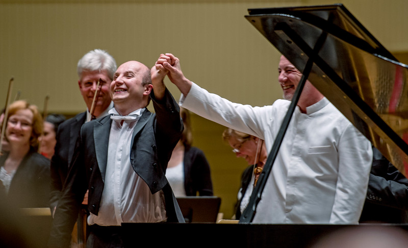 Pianist Alexander Gavrylyuk takes a bow with conductor Rossen Milanov after performing with the Chautauqua Symphony Orchestra Thursday, Jun. 29, 2017, at the Amphitheater. OLIVIA SUN/STAFF PHOTOGRAPHEROLIVIA SUN/STAFF PHOTOGRAPHER