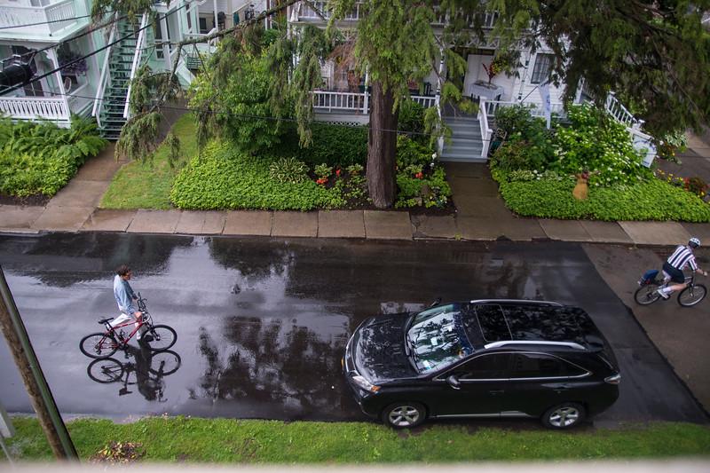 Bikers on Pratt Ave. after the rain on Friday, Jun. 30, 2017. OLIVIA SUN/STAFF PHOTOGRAPHER