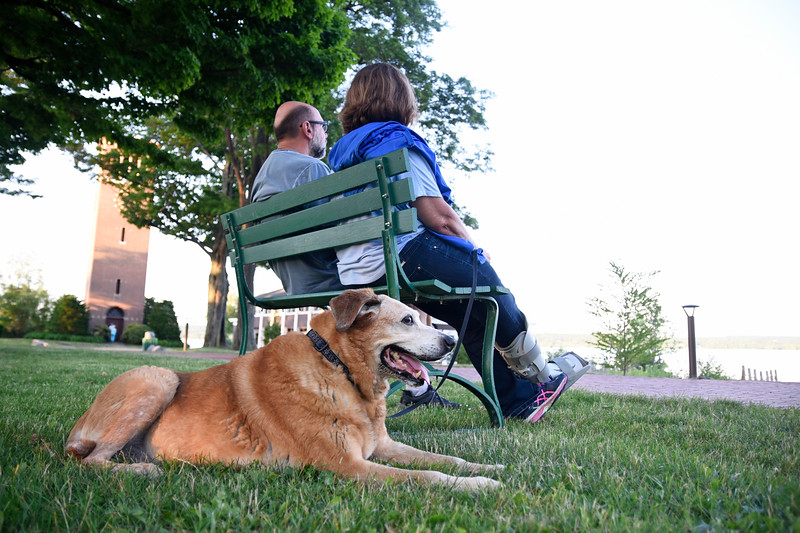 Peter and Janet Steinmetz sit with their dog, Misty, by the Miller Bell Tower on Wednesday, June 14, 2017. OLIVIA SUN/STAFF PHOTOGRAPHER