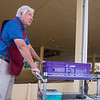 Jay Petersen, amphitheater morning usher, after his daily rounds of book deliveries on Monday, July 3. Petersen is a native of Las Cruces, New Mexico, and has worked at the Amp for five years. OLIVIA SUN/STAFF PHOTOGRAPHER