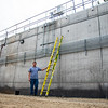 Mike Starks, a Chautauqua Utility District employee, stands next to he Chautauqua sewer plant on Thursday, August 17. Starks is from Mayville, NY, and has a background in environmental science. OLIVIA SUN/STAFF PHOTOGRAPHER